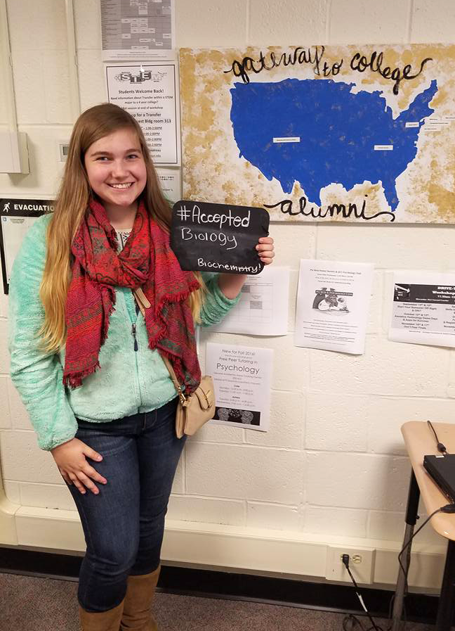 Gateway to College student holds blackboard