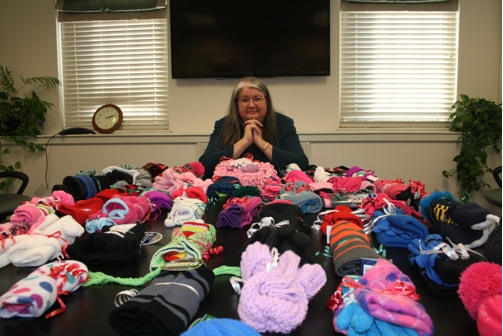 Dr. Gail E. Carberry, President of QCC, with donations.
