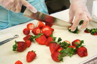 Hospitality student chops strawberries