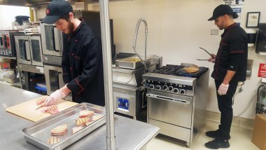 QCC students work in a kitchen environment