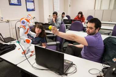 QCC students work with computer software to control robot