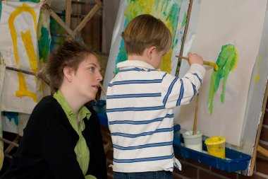 Child painting in QCC's Children's School