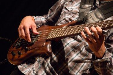 QCC professor Jose Castillo plays guitar
