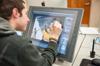 QCC student illustrates with computer screen tablet