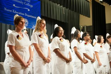 QCC nursing graduates stand for nursing pinning