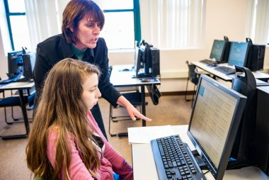 Instructor works with student to use computer programs