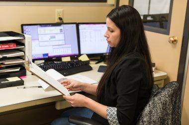 QCC staff member at desk.