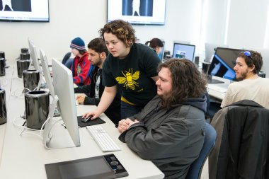 Students collaborate on project in computer lab