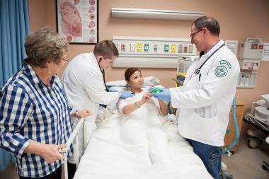 QCC students practice healthcare techniques on patient