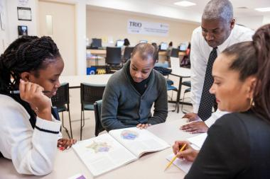 QCC students and instructor discuss textbook