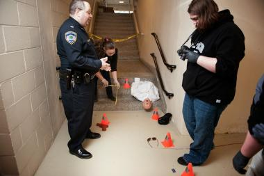 Campus Police officer demonstrates forensic techniques