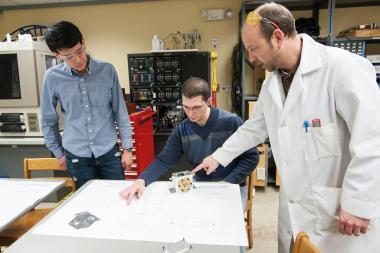 QCC professor shows students equipment