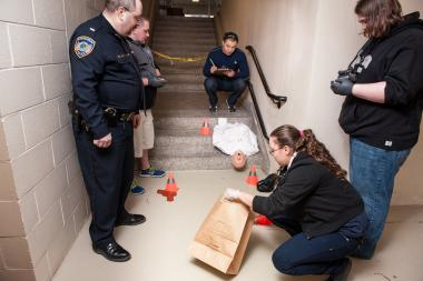 Police officer demonstrates forensic procedure