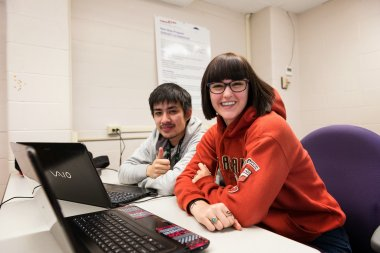 QCC students work on laptops