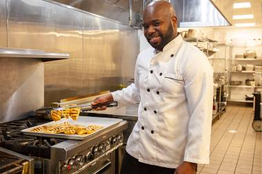 QCC student works in kitchen
