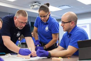 EMT Students participate in a lab