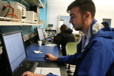 Student works on computer in lab