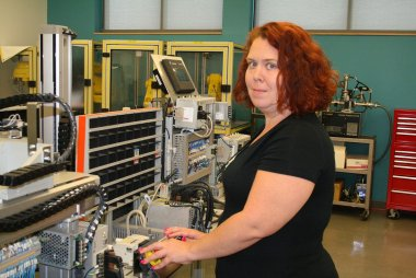 QCC student uses equipment in manufacturing lab
