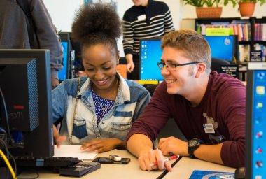 QCC student helps tutor a peer