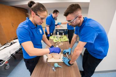 Paramedic students practice in the lab