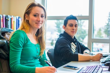 Students study at computer desk