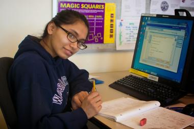 QCC student works at computer desk