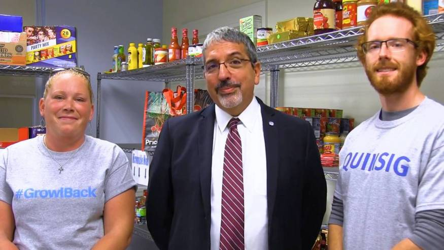 Dr. Pedraja and students inside Food Pantry