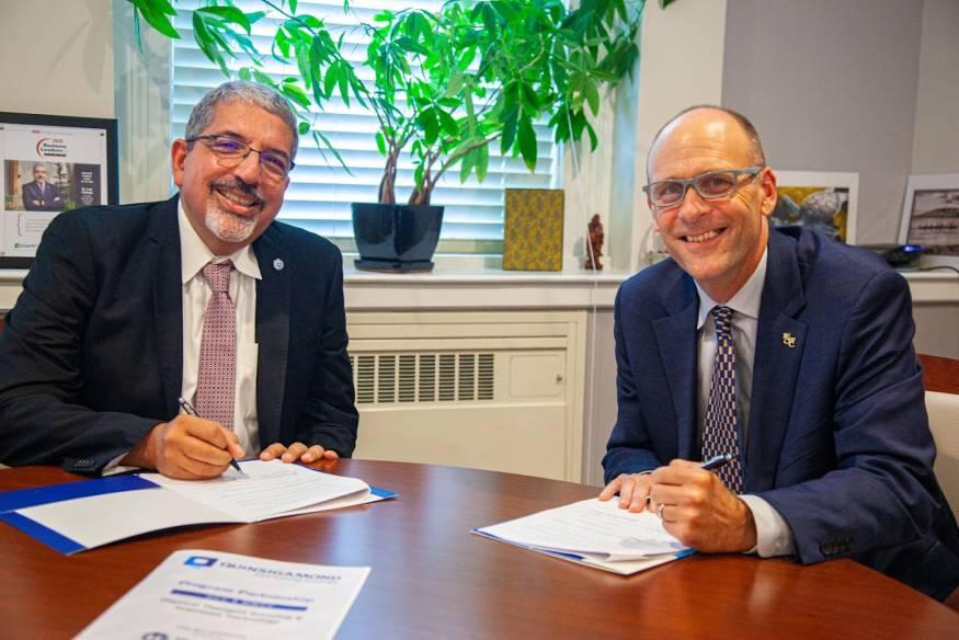 QCC President Luis G. Pedraja (L) and MWCC President James Vander hooven, Ed.D