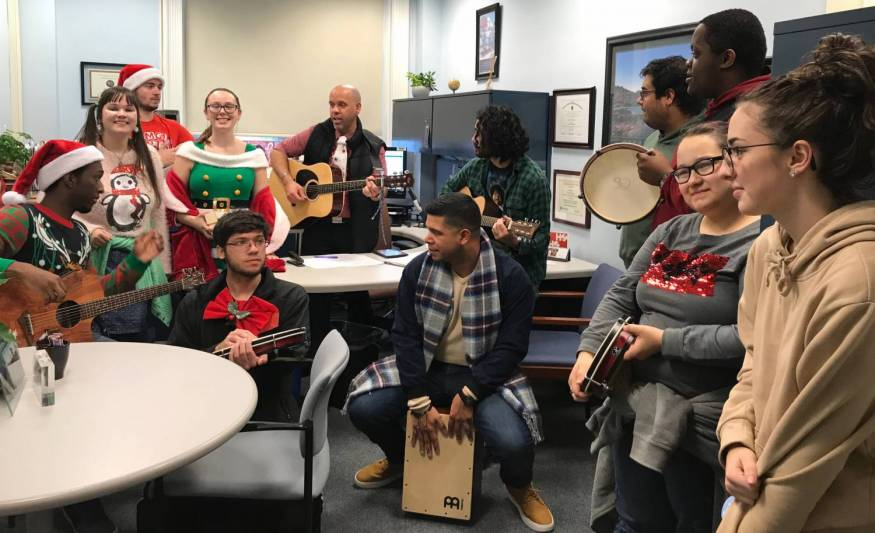 Caroling by Associate Professor Jose Castillo and his music students .
