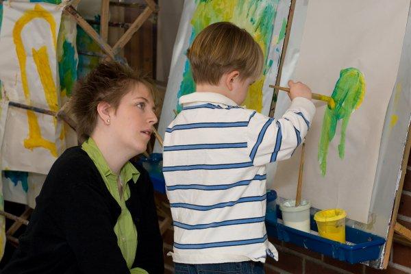 Child painting in QCC's Children's School