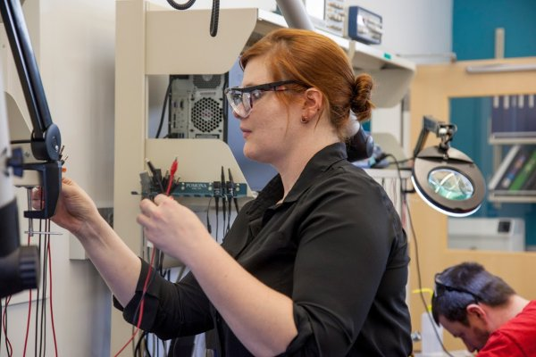 QCC Student works with wires and equipment