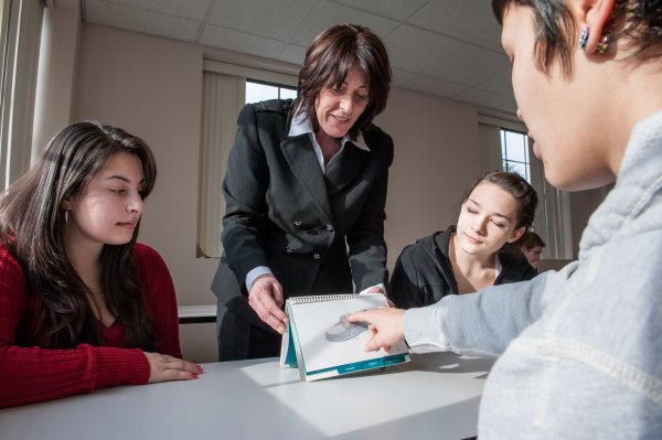 QCC instructor interacts with students
