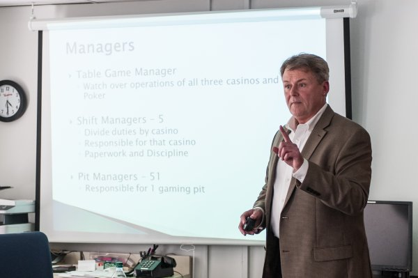 QCC professor give business powerpoint