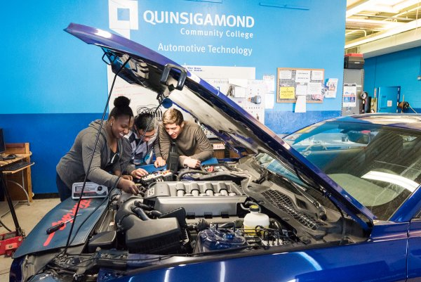 Students work on a car in the QCC automotive classroom