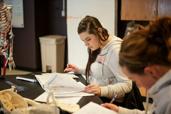 QCC students study in health classroom