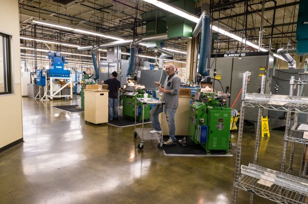 QCC alum works in warehouse environment