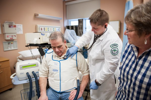 QCC students check patient's breathing