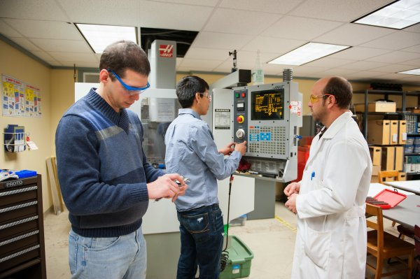 QCC students use manufacturing equipment in lab