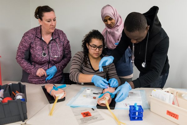Students practice medical techniques