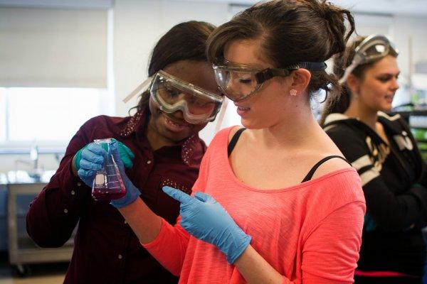 QCC students measure liquids in a beaker