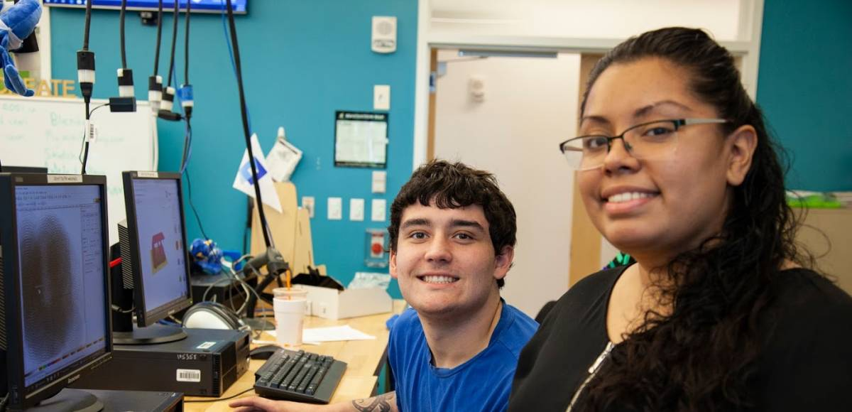 Gateway to College Program Assistant Glenda Rodriguez and student