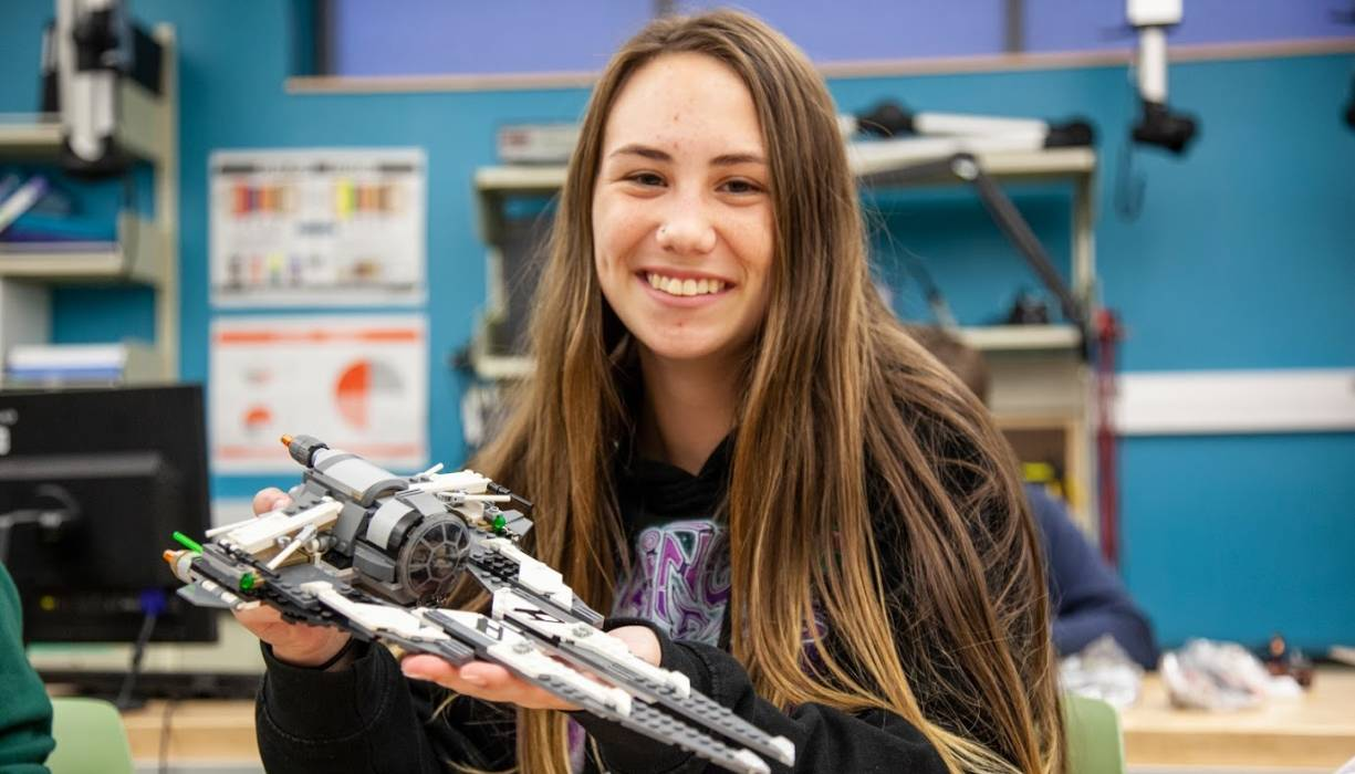 Worcester public high school student Samantha Nordstrom shows off her Star Wars creation.