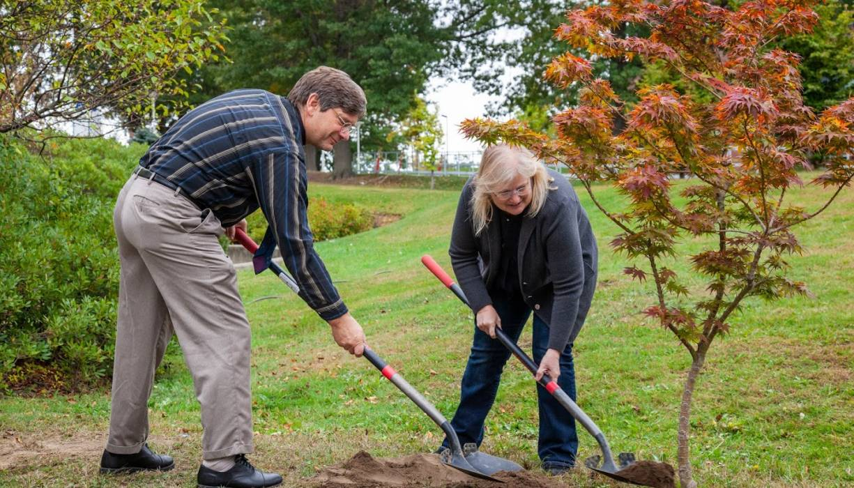 Professor Jacob Longacre and Dean Betty Lauer help plant a memorial tree in honor of Professor Fred Pilch.