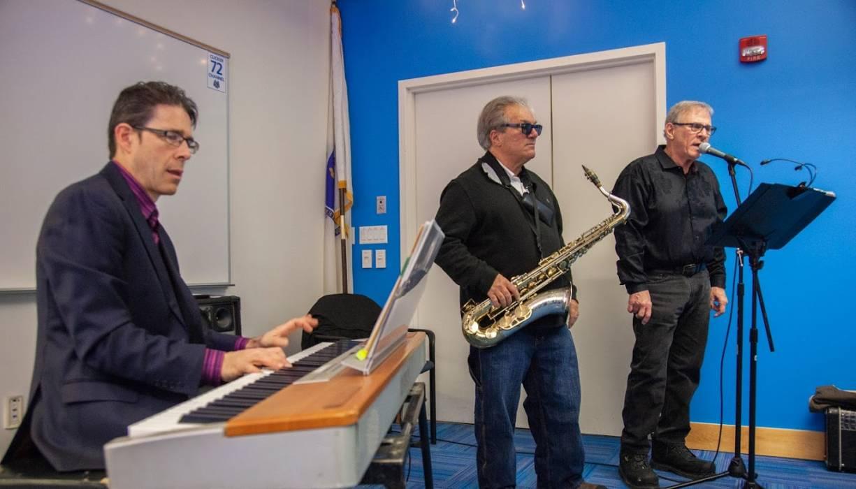 "James ""Jim"" Heffernan, John Solaperto and Tom Hebert perfrom at the Holiday Luncheon."
