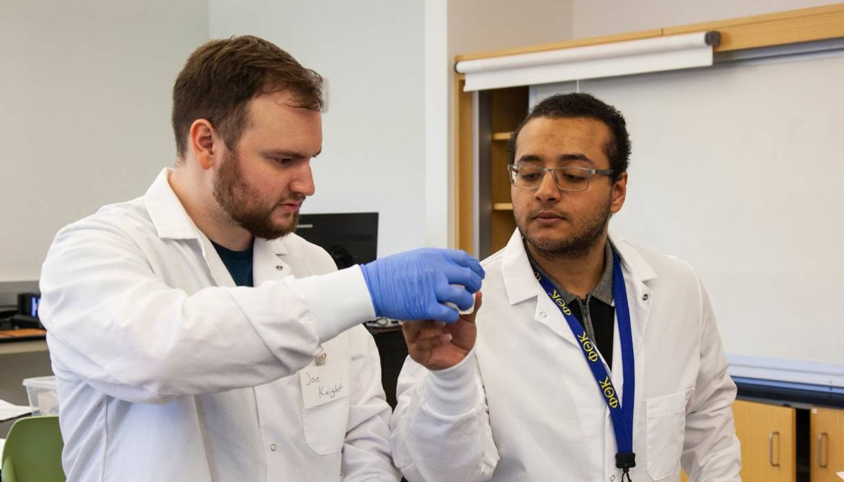 Chemistry lab support technician Kirols Mohareb works with student Joe Knight.