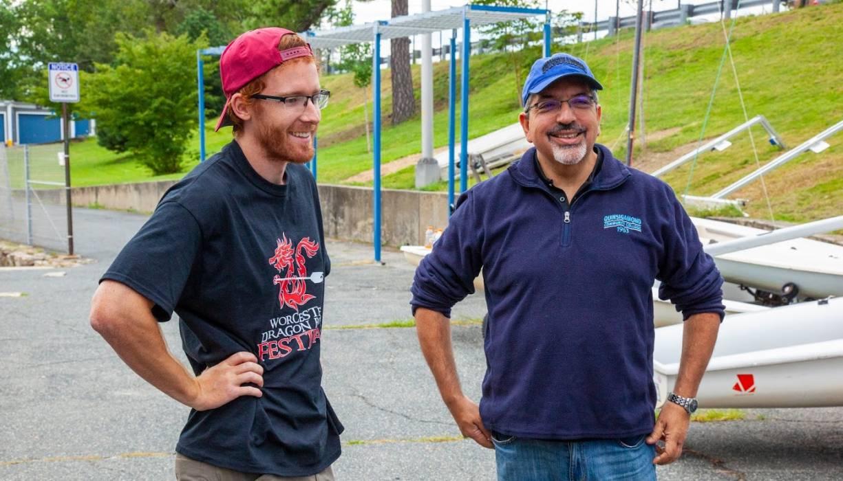 QCC President Dr. Luis Pedraja shares a laugh with PTK student Dan Underwood.
