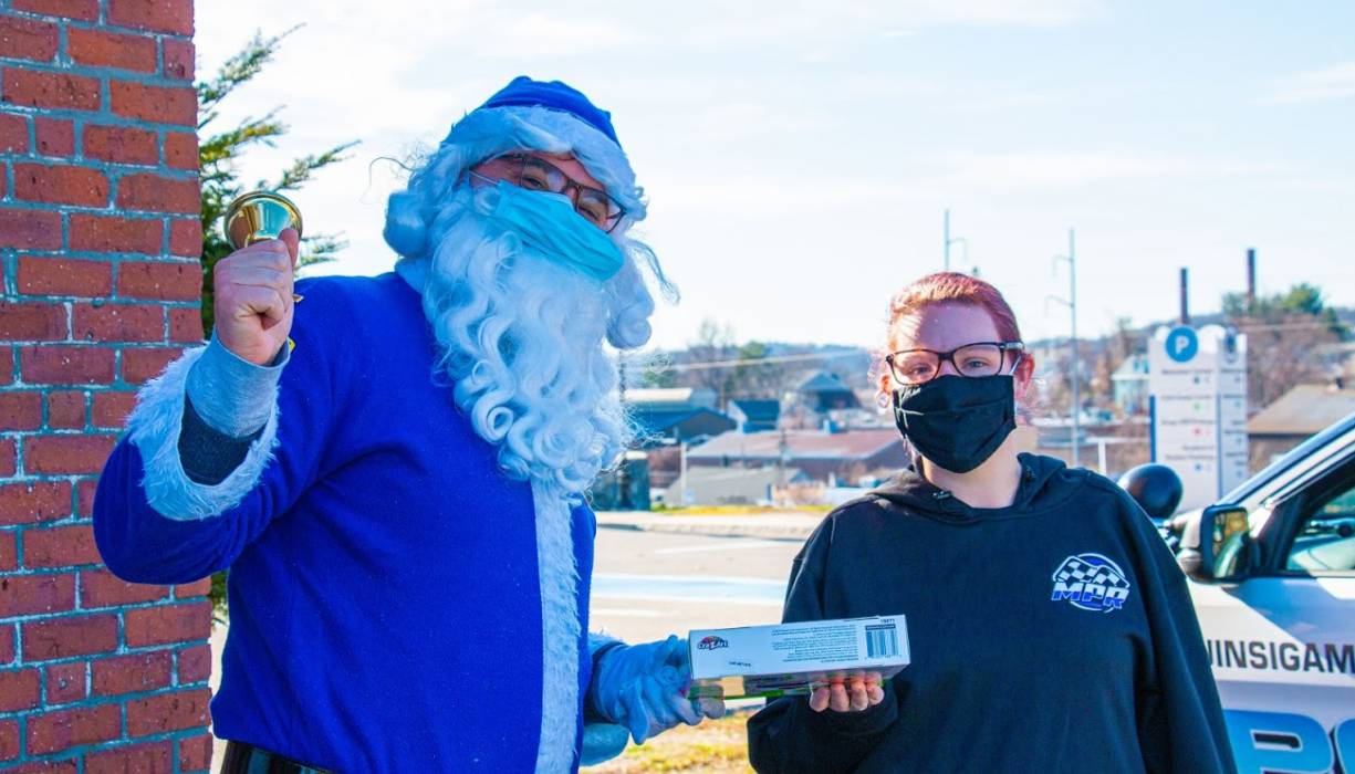 Blue Santa accepts a donation during the 2020 Stuff-A-Cruiser event.