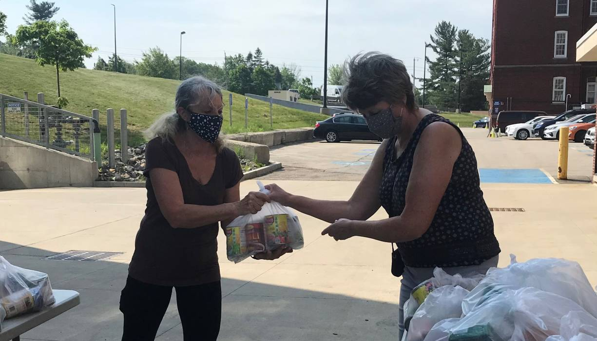 Julie Tzipori (L) and Karen O'Neill (R) of QCC's Early Childhood Education program help out at QCC's weekly food distribution.