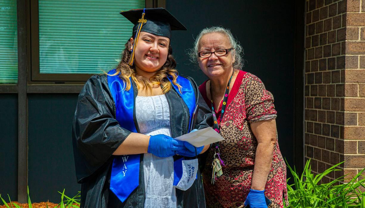 "Gateway graduate Ninoshka ""Nino"" Rabell-Santana proudly shows off her diploma."