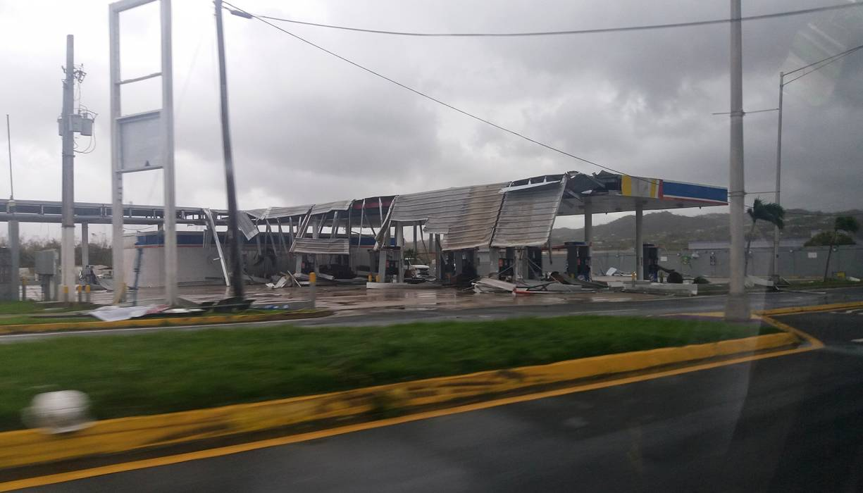 Hurricane Maria's destruction of a nearby gas station.